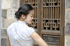 Chinese woman in cheongsam enjoy free time Stock Photos