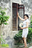Chinese woman in cheongsam enjoy free time Royalty Free Stock Images