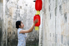Chinese woman in cheongsam enjoy free time Stock Photo