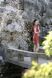 Chinese woman in cheongsam by a fountain in Mudu ancient town Royalty Free Stock Images