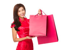 Chinese woman with cheongsam and hold shopping bag Royalty Free Stock Photography