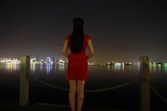 Chinese woman in cheongsam by Jinji lake at beautiful cool night. Chinese woman in cheongsam by Jinji lake,at beautiful cool night, she carry circular fan Royalty Free Stock Photo