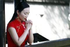 Chinese woman in cheongsam make a wish in Mudu ancient town Royalty Free Stock Photos