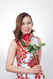 Chinese woman in cheongsam with rose. royalty free stock photos