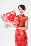 Chinese woman in cheongsam with traditional ornament Royalty Free Stock Photo