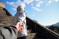 A Chinese woman on China Badaling Great Wall. A Chinese women on China Badaling Great Wall, sit on China Badaling Great Wall, long hair, blue jeans, black Royalty Free Stock Photos