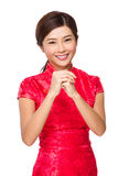 Chinese woman with congratulation hand gesture Stock Image