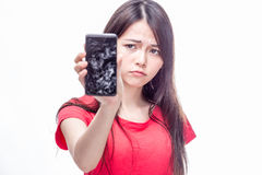 Chinese woman with cracked cell phone Royalty Free Stock Photos