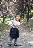 Chinese woman dancing in the woods 03. Chinese woman dancing in the park's little woods Royalty Free Stock Photos