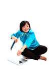 Chinese Woman destroying laptop with saw Royalty Free Stock Image