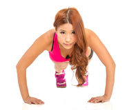 Chinese woman doing pushups Stock Image