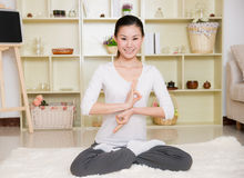 Chinese woman doing yoga Royalty Free Stock Images