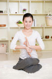 Chinese woman doing yoga Stock Photos