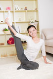 Chinese woman doing yoga Stock Photo