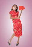 Chinese woman dress cheongsam and hold red envelope Royalty Free Stock Photo