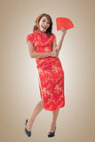 Chinese woman dress cheongsam and hold red envelope Royalty Free Stock Image