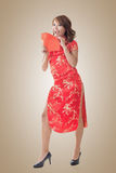 Chinese woman dress cheongsam and hold red envelope Royalty Free Stock Images