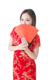Chinese woman dress traditional cheongsam and hold Stock Photography