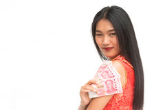 Chinese woman dress traditional cheongsam hold some of b. Smiling Chinese woman dress traditional cheongsam hold some of bank notes in hand Royalty Free Stock Photography