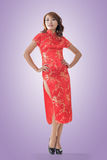 Chinese woman. Dress traditional cheongsam at New Year, full length portrait isolated Stock Photo