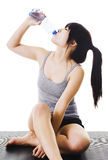 Chinese woman drinking water. Royalty Free Stock Image