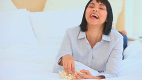 Chinese woman eating popcorn stock footage
