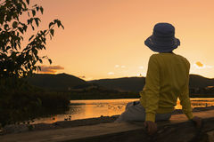 Chinese woman enjoying sunset Royalty Free Stock Photo
