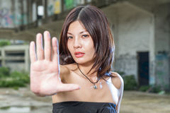 Chinese woman gesturing no with hand Stock Images
