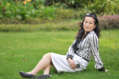 A chinese woman on the grass. A chinese woman who was showing for photo on the grass royalty free stock photos
