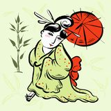Chinese woman in a green kimono with red umbrella Royalty Free Stock Images