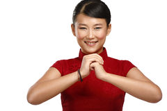 Chinese woman greeting gesture in elegant red dress Royalty Free Stock Image