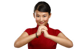 Chinese woman greeting gesture in elegant red dress. On white Stock Photos
