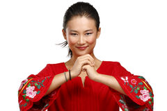 Chinese woman greeting gesture in elegant red dress Stock Image