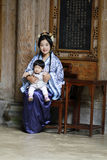 Chinese woman in Hanfu dress, hold her baby in cheongsam Royalty Free Stock Photos