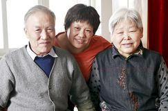 Chinese woman with her parents. At home Stock Photo