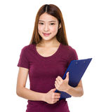 Chinese woman hold with clipboard Stock Images
