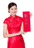 Chinese woman hold with Fai Chun, phrase meaning is blessing for Stock Image