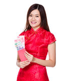 Chinese woman hold lucky money with RMB Stock Image