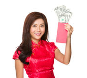 Chinese woman hold with lucky money with USD. Isolated on white background Stock Photo