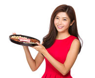 Chinese woman hold with lunar traditional snack tray Royalty Free Stock Image