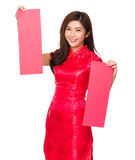 Chinese woman hold with pair of red poster Royalty Free Stock Photos