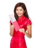 Chinese woman hold with red lucky money with RMB. Isolated on white background Royalty Free Stock Photos