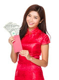Chinese woman hold red pocket money with USD Stock Photography