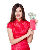 Chinese woman hold red pocket with USD Stock Image