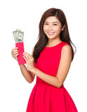 Chinese Woman hold red pocket with USD Stock Images