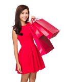 Chinese Woman hold with red shopping bag Royalty Free Stock Image