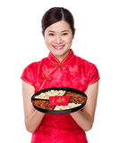 Chinese woman hold with snack tray Stock Photos