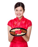 Chinese woman hold with snack tray for lunar new year Stock Photography