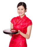 Chinese woman hold snack tray for new year Royalty Free Stock Images