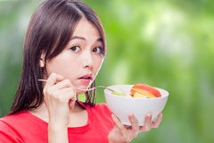 Chinese woman holding bowl of fruit royalty free stock photography